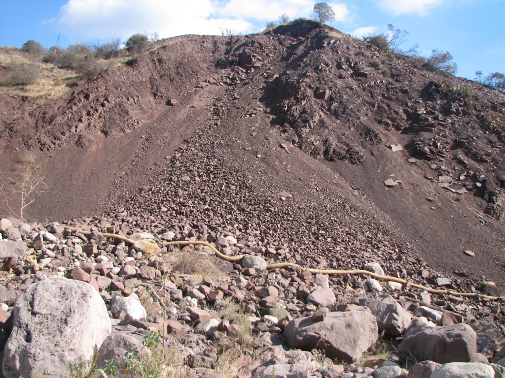 Rocks and debris falling into Sespe Creek from unpermitted road construction above.